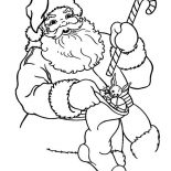 Christmas, Santa Claus Holding A Candy Cane And Christmas Stocking On Christmas Coloring Page: Santa Claus Holding a Candy Cane and Christmas Stocking on Christmas Coloring Page